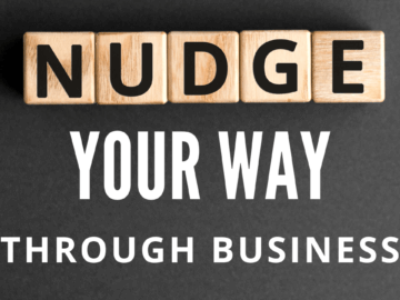 scrabble letters spelling out nudge your way through business.